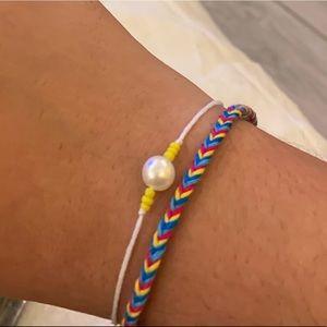 Pearl string bracelet & fishtail friendship